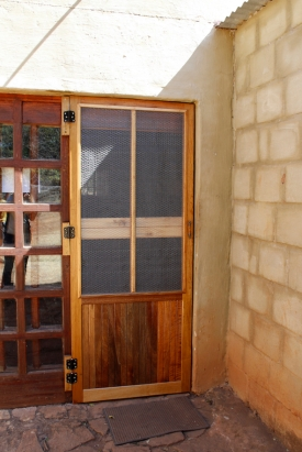 A special door was installed at the Barn to keep monkeys from entering.